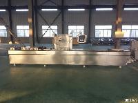 小康牌DLZ-520D型全自动豆干连续拉伸膜真空包装机